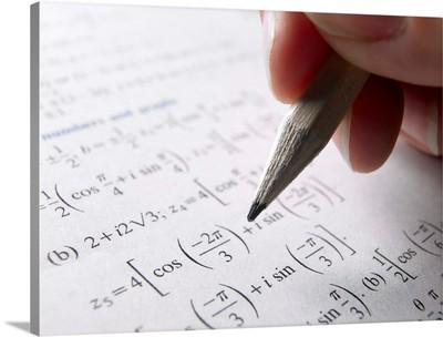 Hand doing math homework