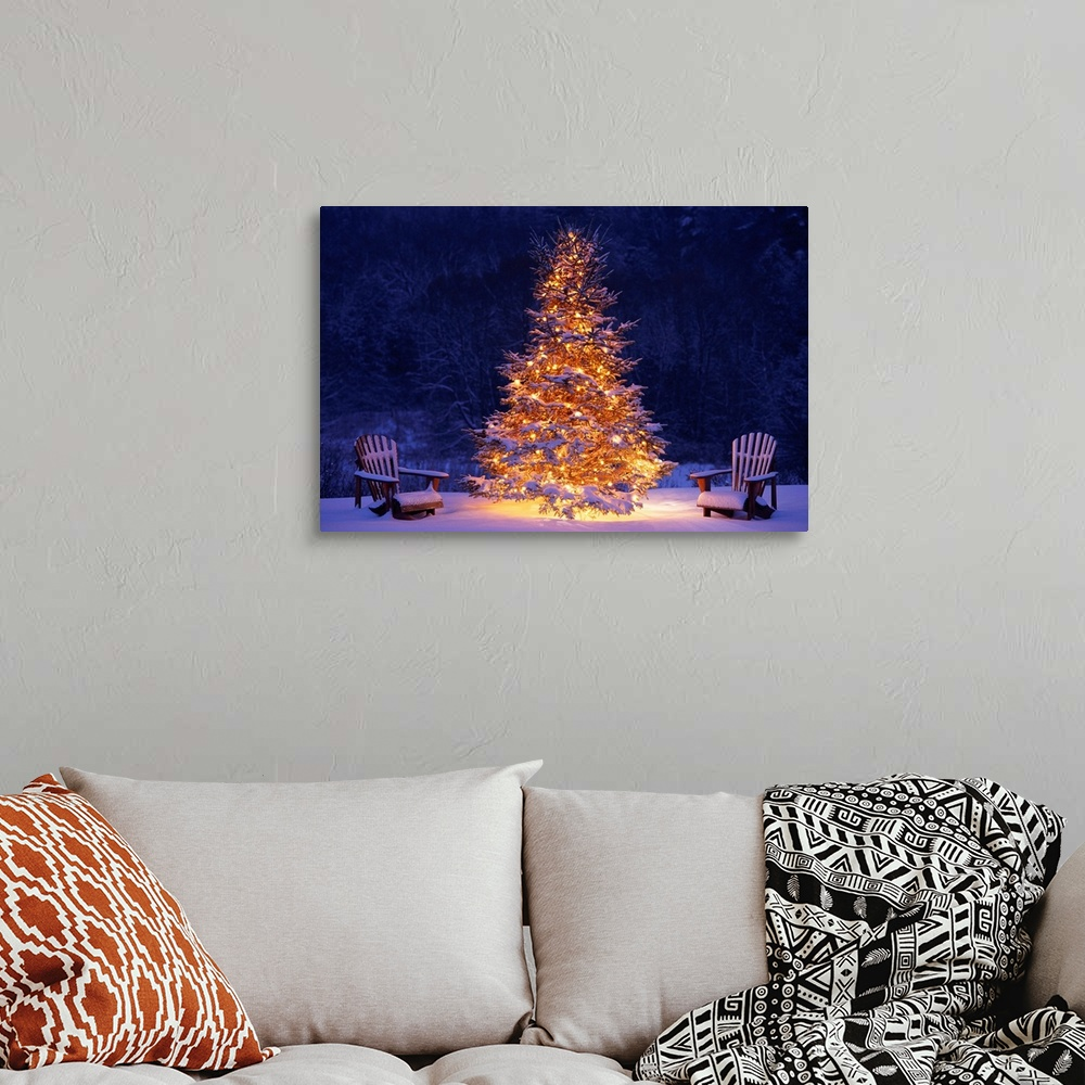 Snow Covering Adirondack Chairs By Lit Christmas Tree Wall
